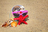 Starfish and shells on the sand — Stock Photo