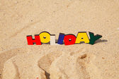 Wooden colorful word 'Holiday' — Стоковое фото