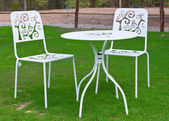 White table and chairs in lawn — Stock Photo
