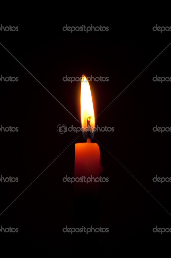 Candle flame on black background — Stock Photo #11530027