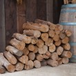 Snow log stack lumber in winter. Woodpile of pine — Stock Photo #12160397