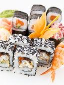 A set of Asian rolls, sushi and sashimi — Stock Photo