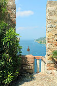 Views of lake garda with the ancient stone balcony — Stock Photo