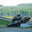 Tank T-80 shoots sideward - Stock Photo
