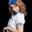 Young beautiful air hostess — Stockfoto