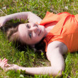 Pretty girl laying on grass — Stock Photo