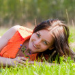 Pretty girl laying on grass — Stock Photo #11585604