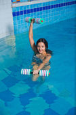 Attractive girl trains in aqua aerobics — Stock Photo