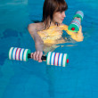 Stock Photo: Attractive girl trains in aquaerobics