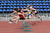 Yalta, Ukraine - May 24 girls age 17 at the hurdles race on the international athletic meet UKRAINE - TURKEY - BELARUS on May 24, 2012 in Yalta, Ukraine — Stock Photo