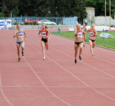 Yalta, Ukraine, May 28: (L-R) Piatochenko Viktoria, Bryzgina Elyzaveta, Mariya Ryemyen and Pogrebniak Natalia on the finish of 200 meters dash on the Ukrainian Cup in Athletics, on May 28, 2012 in Yal — Stock Photo