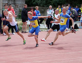 YALTA, UKRAINE, MAY 29: Unidentified men at the relay race on Ukrainian Cup in Athletics, on May 29, 2012 in Yalta, Ukraine — Stock Photo