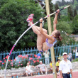 Girl competes in pole vault competition — Stock Photo #10987681