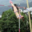 Stock Photo: Girl competes in pole vault competition