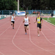 Boys compete in 100 meters race — Stock Photo #10987768