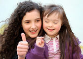 Portrait of beautiful young girls on the playground — Stock Photo