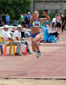 Nikolaeva Irina competes in the triple jump competition on Ukrainian Cup in Athletics, on May 29, 2012 in Yalta, Ukraine. — Stock Photo