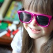 Portrait of beautiful young girl smiling with sunglasses. — Stock Photo #11071211