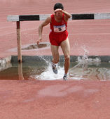 Tekal Ersin from Turkey competes in the 2000 Meter Steeplechase race on international youth athletic meet between Ukraine, Turkey, Belarus on May 24, 2012 in Yalta, Ukraine — Stock Photo