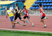 YALTA, UKRAINE - MAY 25: (L-R) Pozdniakov Oleksei, Pozhar Dmitro, Altintash Batuhan, Uznal Enis on relay race on the athletic meet between UKRAINE, TURKEY, BELARUS on May 25, 2012 in Yalta, Ukraine — Zdjęcie stockowe