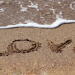"The word ""love"" written on the sand of a beach. — Stock Photo"