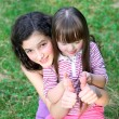 Stock Photo: Portrait of beautiful young girls in the park