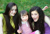 Happy little girl with sisters — ストック写真