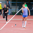 Denis Yurchenko on pole vault competition - Stock Photo