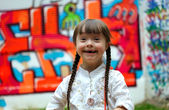 Portrait of beautiful young girl on the colorful background. — Stock Photo