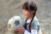 Portrait of beautiful happy girl with a soccer ball. — Stock Photo