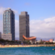 Overview of Barcelona Spain from Barceloneta beach. — Stock Photo