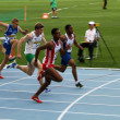 Athletes compete in the 110 meters final on the 2012 IAAF World Junior Athletics Championships on July 12, 2012 in Barcelona, Spain. — Stock Photo