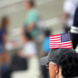 The American flag on the cap at the stadium fans — Stock Photo