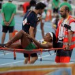 Red Cross providing first aid to injured athlete on the 2012 IAAF World Junior Athletics Championships on July 12, 2012 in Barcelona, Spain. — Stock Photo #11927674