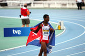 Yordan L. O'Farrill from Cuba celebrates winning of the 110 meters hurdles final on the 2012 IAAF World Junior Athletics Championships on July 12, 2012 in Barcelona, — Stock Photo