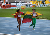 Ana Peleteiro and Dovilé Dzindzaletaité celebrate the gold and silver medal in triple jump on 2012 World Junior Athletics Championships on July 12, 2012 in Barcelona, Spain — Stock Photo