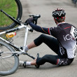 Fallen cyclist — Stock Photo