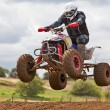 Quad bike jumping - Stockfoto