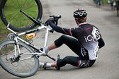 Fallen cyclist — Stock Photo