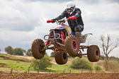 Quad bike jumping — Stock Photo