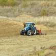 Tractor plowing land — Stock Photo