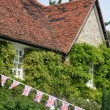 Cottage with union flags — Stock Photo