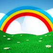 Green field with rainbow - Stock Photo