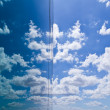 Cloud and sky reflection in mirror of building — Stock Photo