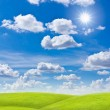 Stock Photo: Meadow against blue sky