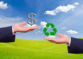 Business man hand exchange dollar sign and recycle icon — Stock Photo