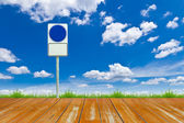 Wood way and blank sign on blue sky — Stock Photo
