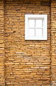 White window on the stone wall — Stock Photo