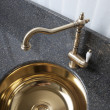 Retro-style faucet on bronze sink — Stock Photo