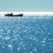View of the sea and fishermen in the boat — Stock Photo